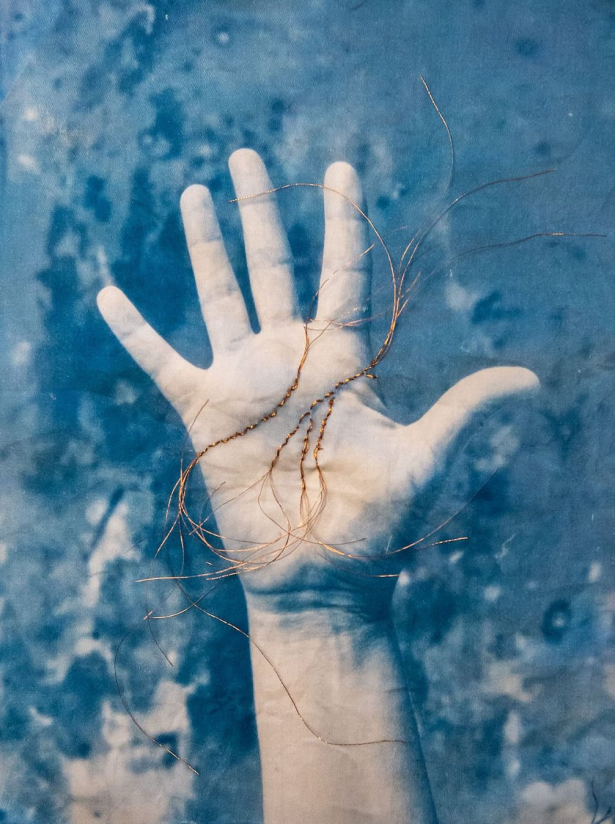 """Palmistry,"" 2019. Cyanotype on fabric, copper thread embroidery"