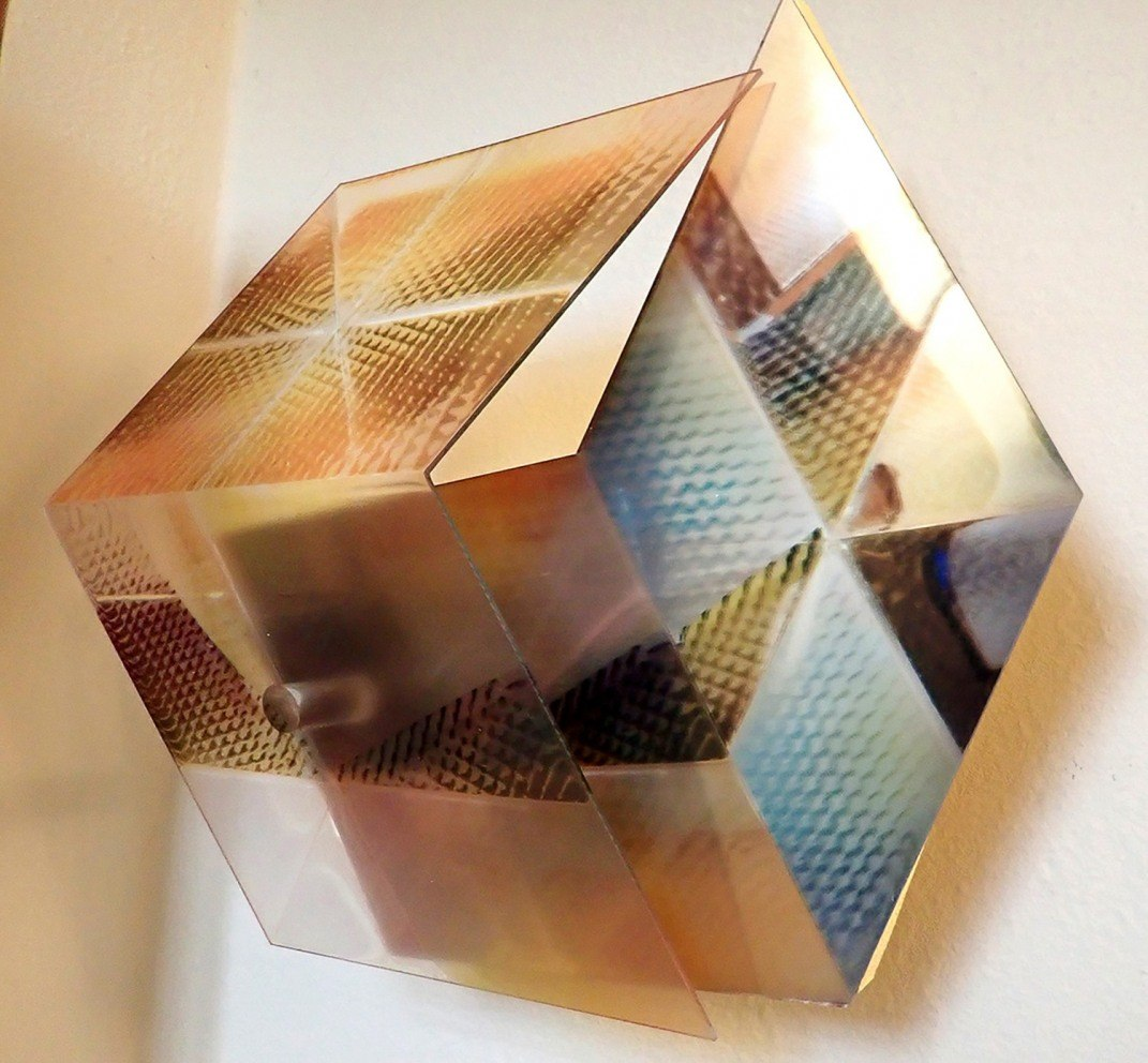 """""""Fly-Apart Cube II"""", 2020. Thermoformed UV-fused prints on laser-cut transparent and mirrored acrylic sheets with painted wood backings."""